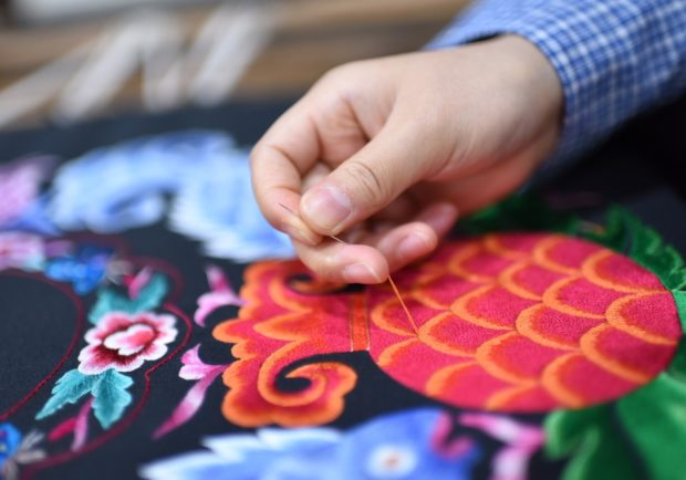 Miao embroidery creates 500,000 jobs for women in SW China's Guizhou province